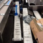 Flighted Transport Conveyor for Pouches